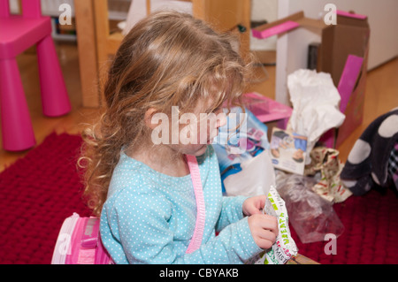 3 Year Old Child Girl Infant Toddler Opening A Xmas Christmas Present presents Gift - Stock Photo
