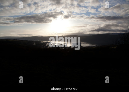 Area of the Gare Loch, Scotland. Silhouetted view of the Royal Navy submarine base at Faslane on the Gare Loch. - Stock Photo