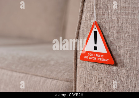 Sofa fire safety warning label - Stock Photo