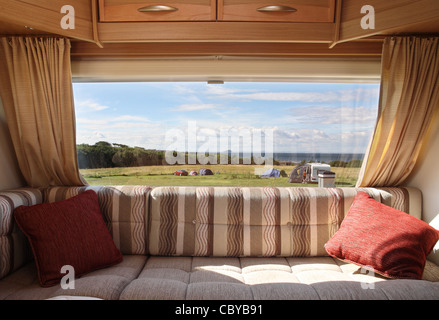 View from within a touring caravan looking out over the Firth of Forth from Dunbar towards Bass Rock, Scotland, - Stock Photo