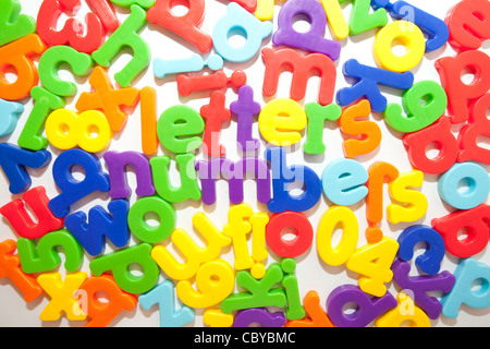 coloured letters and numbers on fridge - Stock Photo