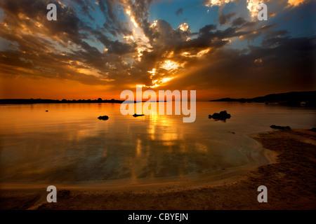 Sunset at Elafonissos (or 'Elafonissi') beach, Chania Prefecture, Crete, Greece - Stock Photo