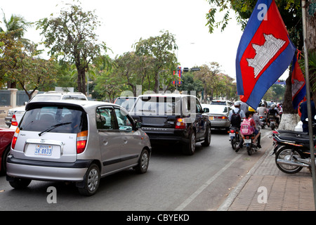 Traffic jam with cars, SUVs, bikes, scooters and bicycles in Phnom Penh, Cambodia, Asia - Stock Photo