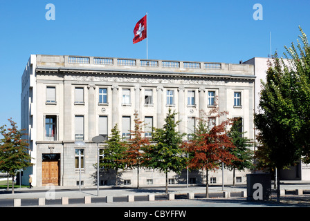 Embassy of Switzerland in Berlin with the Swiss national flag. - Stock Photo