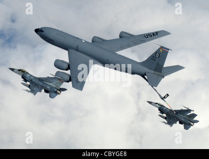 A KC-135 Stratotanker from Royal Air Force Mildenhall, England, refuels a pair of F-16 Fighting Falcons April 7 - Stock Photo