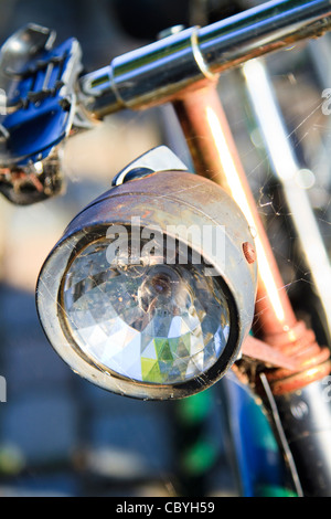 An old rusting vintage bicycle covered in cobwebs - Stock Photo