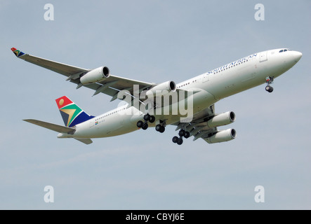 South African Airways Airbus A340-200 (ZS-SLD) lands at London Heathrow Airport, England. - Stock Photo