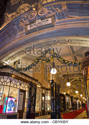 Burlington traditional luxury London shopping arcade entrance in Piccadilly with Christmas lights and decorations - Stock Photo