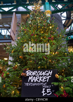 Christmas tree at Borough Market a renowned popular international produce retail market Southwark London - Stock Photo