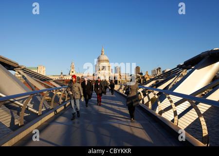 people crossing the millenium bridge London England UK United kingdom - Stock Photo