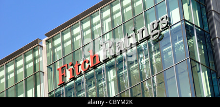 Credit rating agency & financial services company Fitch Ratings sign & logo on office building in London Docklands - Stock Photo