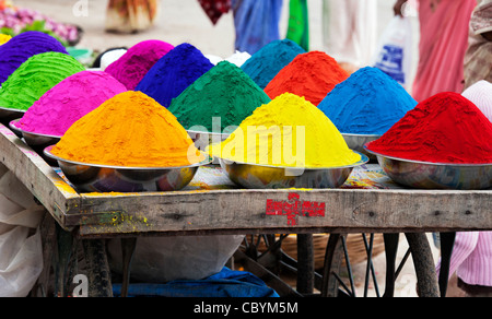 Coloured Indian powder in metal bowls used for making rangoli designs at festivals - Stock Photo