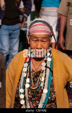 India, Arunachal Pradesh, Along, Kombo, Hurin harvest festival, woman wearing necklace made of old silver coins - Stock Photo