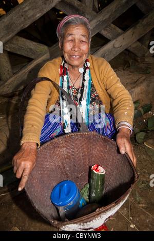 India, Arunachal Pradesh, Along, Kombo, Hurin harvest festival, woman resting between dancing - Stock Photo