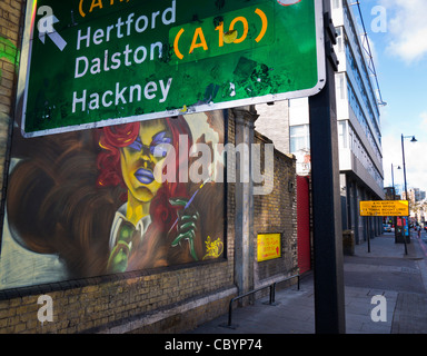 Traffic sign and graffiti on Great Eastern Street, Shoreditch, London, UK. - Stock Photo