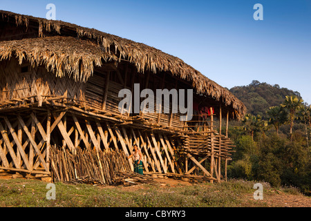 India, Arunachal Pradesh, Along, Kombo, woman outside house from locally sourced natural materials - Stock Photo