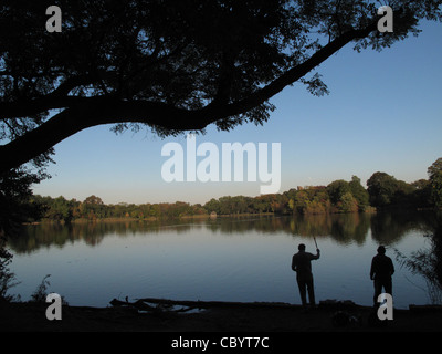People fish in a lake in Prospect Park, Brooklyn, New York, November 9, 2011. - Stock Photo