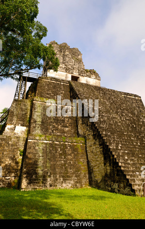 TIKAL, Guatemala - The Temple of the Masks (or Temple 2) on one side of the Main Plaza in the Tikal Maya ruins in - Stock Photo