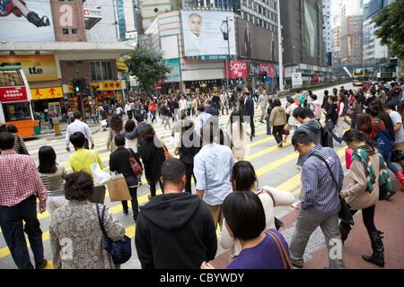 crowd of chinese shoppers on pedestrian crossing yee wo street causeway bay hong kong hksar china asia - Stock Photo