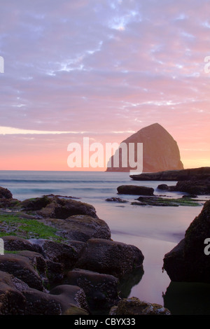 Oregon Pacific City Beach with Haystack Rock in the Distance - Stock Photo