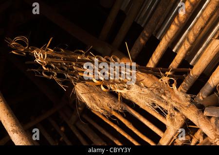 India, Arunachal Pradesh, Along, Kombo Monku village, symbolic structure woven fron bamboo in new house roof - Stock Photo