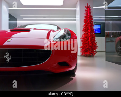 Red ferrari 39 california 39 sports car on display for sale in for Ferrari christmas