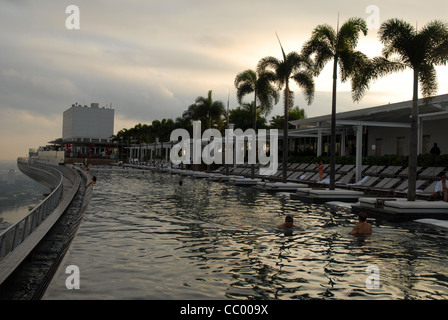 Sands SkyPark infinity swimming pool on the 57th floor of Marina Bay Sands Hotel, Marina Bay, Singapore - Stock Photo