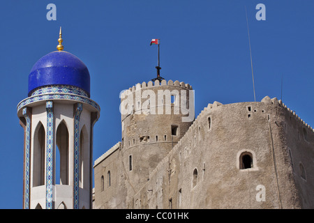THE MINARET OF THE AL KHAWR MOSQUE IN FRONT OF THE AL MIRANI FORT IN OLD MUSCAT, SULTANATE OF OMAN, MIDDLE EAST - Stock Photo