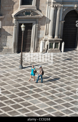 Tourists walking in the city center of Granada, Andalucia, Spain - Stock Photo