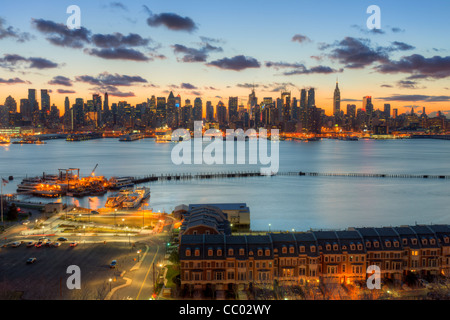 The Manhattan skyline during morning twilight as viewed over the Hudson River looking east from New Jersey. - Stock Photo