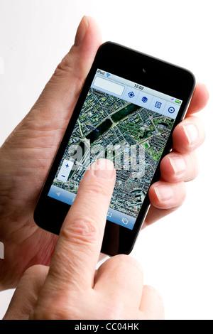 Using Maps on an Apple iPod - Stock Photo