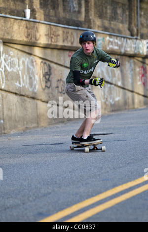 Young male skateboarder on urban street. - Stock Photo