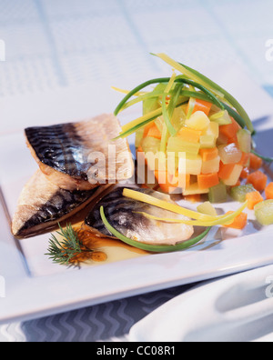 cooking Mackerels with Vegetable - Stock Photo