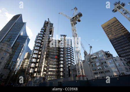 122 leadenhall street building under construction site with lloyds building in the city of London England UK United - Stock Photo