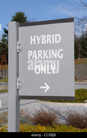 Sign indicating that preferred parking is available for hybrid gas-electric cars at an eco-friendly hotel in Massachusetts. - Stock Photo