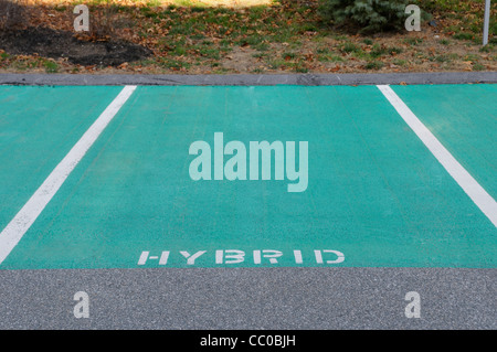 Preferred parking spaces reserved for hybrid gas-electric cars at an eco-friendly hotel in Massachusetts - Stock Photo