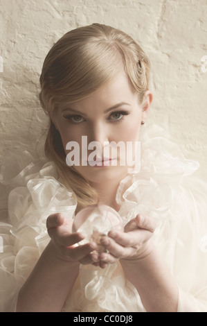 Beautiful woman holding a crystal ball - Stock Photo