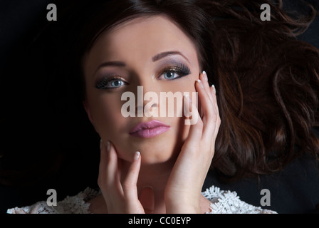 Beautiful young woman hands on face - Stock Photo