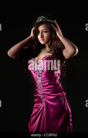 Beautiful young woman wearing a crown - Stock Photo