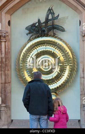 Grasshopper or Corpus Christi Clock, Kings Parade, Cambridge UK - Stock Photo