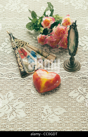 Glass heart , fan, roses and oval frame - Stock Photo