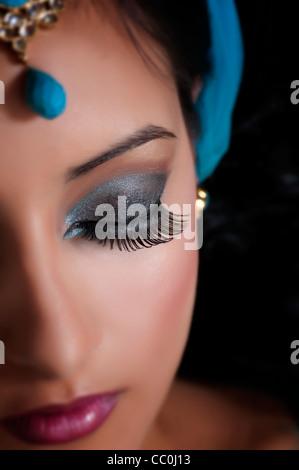 Beautiful Indian woman eyes closed - Stock Photo