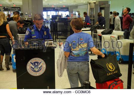 Miami Florida International Airport MIA aviation Department of Homeland Security TSA checkpoint anti-terrorism safety - Stock Photo