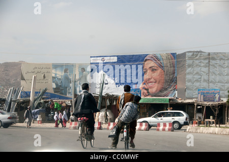 Kabul. Advert for mobile phone, using a photo of a woman. - Stock Photo