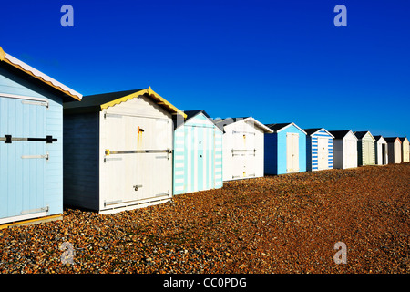 Row of beach huts on a bright day, near Hastings, East Sussex - Stock Photo