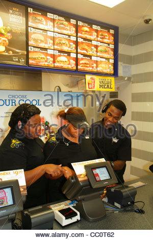 New Orleans Louisiana French Quarter Burger King restaurant fast food chain hamburger sandwich Black man woman young - Stock Photo