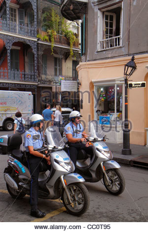 New Orleans Louisiana French Quarter Royal Street street scene NOPD police policeman officer job man motorcycle - Stock Photo