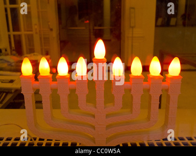 lighted menorah in apartment building lobby - Stock Photo