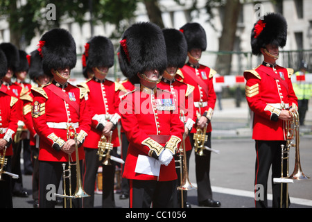 Military band wearing bearskin hats on Veterans' day in London,England. - Stock Photo