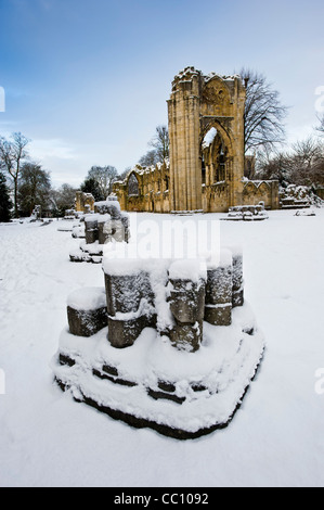Ruins of St Mary's Abbey, Museum Gardens, York, in snow. - Stock Photo